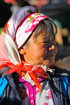 Woman in traditional Chinese minority tribal head covering