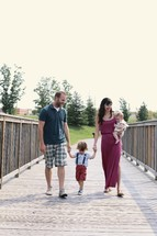 a happy family taking a walk outdoors