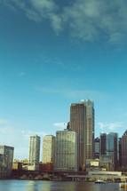 skyscrapers along a river