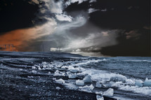 ice chunks and waves along a stormy shore