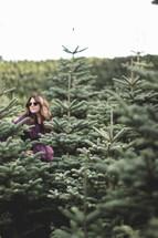 a woman at a Christmas tree farm