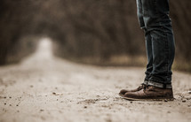 standing on a dirt road