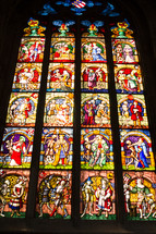 An elaborate stained glass church window.