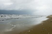 Wet sand on a beach.