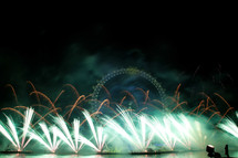fireworks surrounding the London Eye for New Years eve celebration