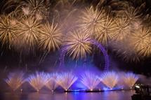 fireworks over a ferris wheel at an amusement park