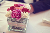 carnation flower arrangement at the center of a table