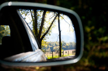 country view through a rearview mirror