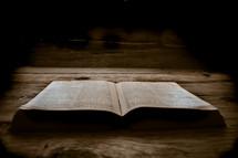 open Bible on wood boards