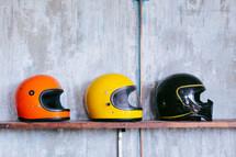 row of motorcycle helmets