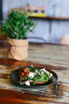 food on a plate and house plant on a table