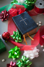 A Bible in the middle of Christmas decorations