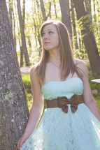 teen girl standing outdoors in a prom dress