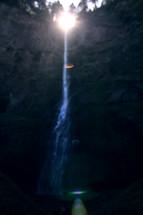 Sun shining on a waterfall.