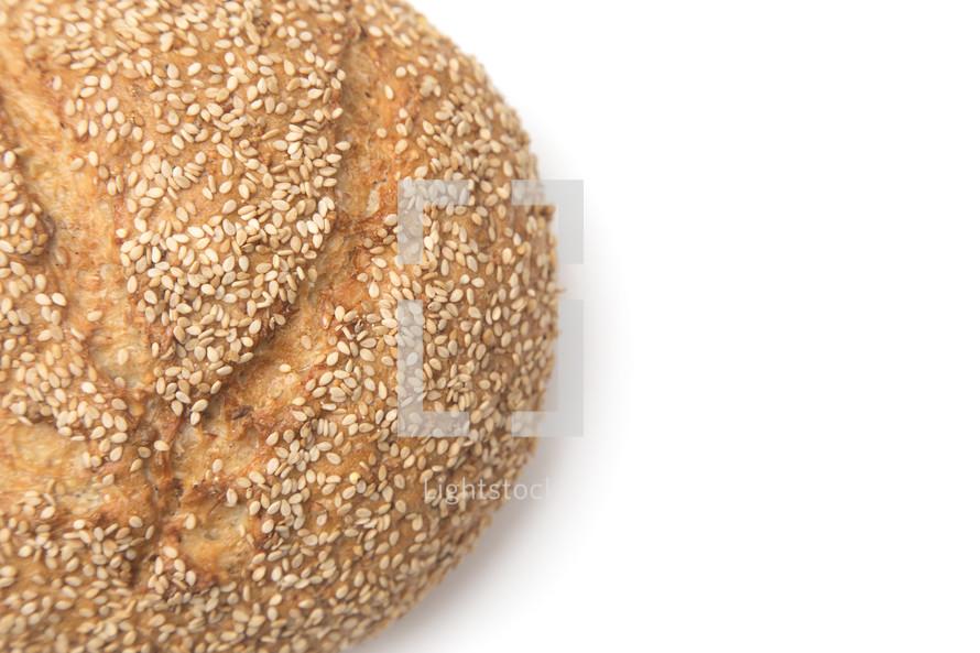 sesame seeds on a loaf of bread