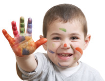 toddler boy with paint on his hands