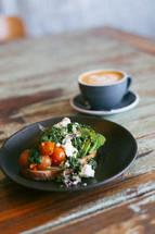 food on a plate and coffee mug