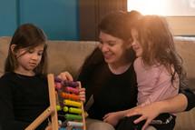 mother teaching her children math
