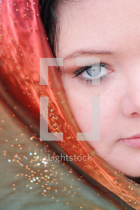 eyes of a veiled woman