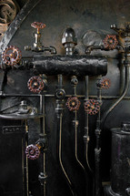 Copper pipes and knobs on a boiler.