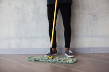 pushing a dust mop