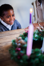 mother and son lighting an Advent Wreath