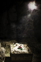 A small gift representing Jesus lying in a manger