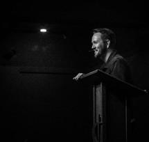 man preaching a sermon