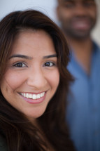 head shots of a man and woman smiling