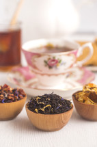 Loose Leaf Tea in a Wooden Bowl, tea cup, and honey