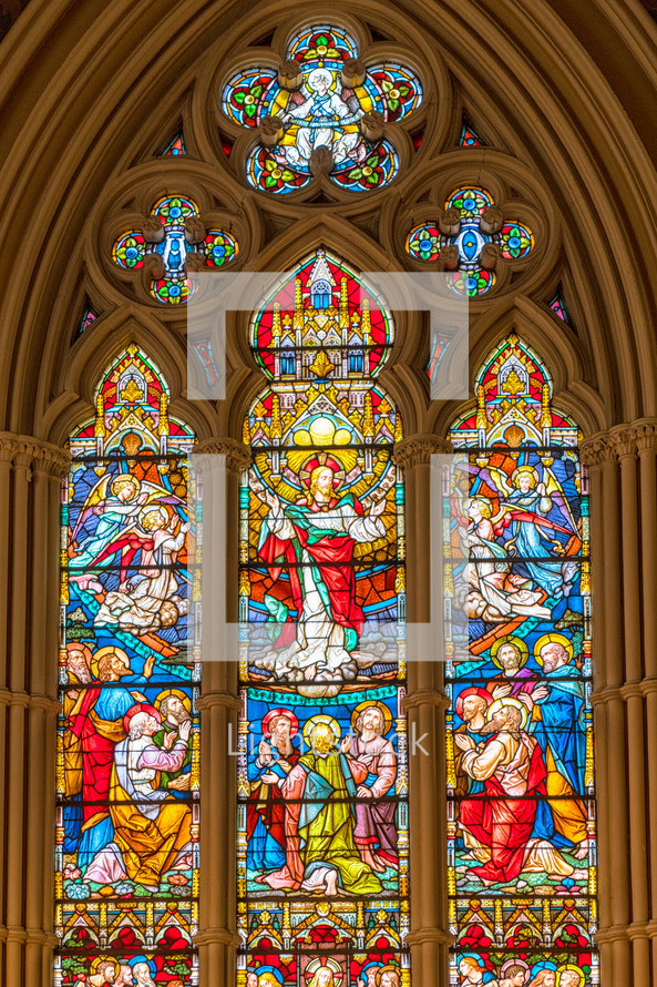 stained glass window of Jesus and his disciples