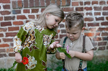 girl and boy picking flowers