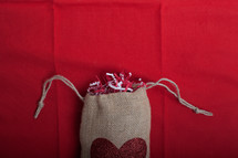 confetti in a burlap sac with a heart
