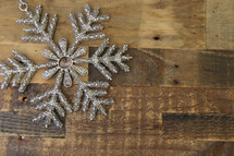 Snowflake against a wood floor background