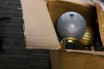 box of Christmas ornaments