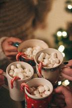 toasting with hot cocoa mugs