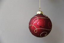red and gold hanging Christmas ornament