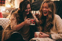 friends laughing in conversation over hot cocoa