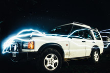 bolts of electricity around an SUV