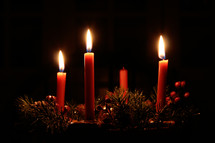 three candles burning on an advent wreath