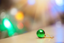 bokeh light and a green ball ornament