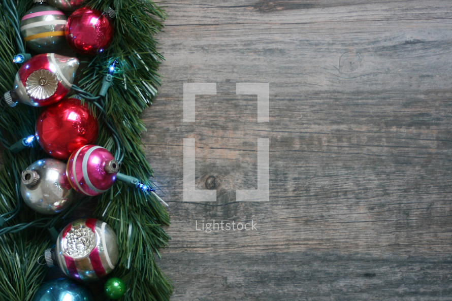 Christmas background with greenery with ornaments