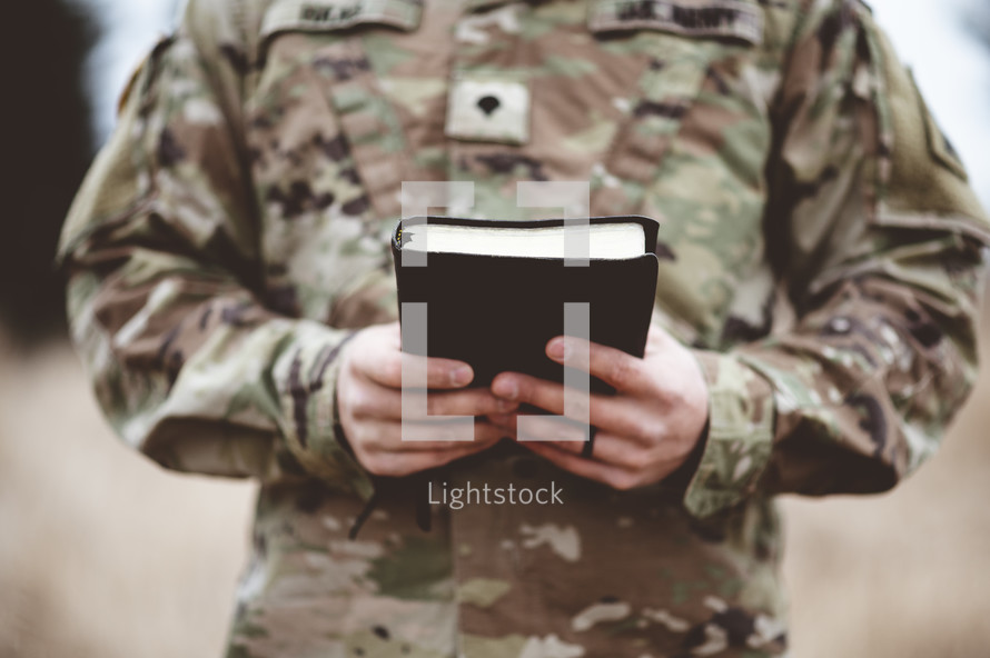 soldier holding a Bible