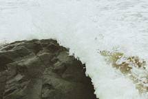 sea water washing onto rocks