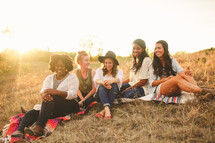 friendship, friends, young woman, african american, woman, college, outdoors, sitting, hill, sunset, blankets, grass
