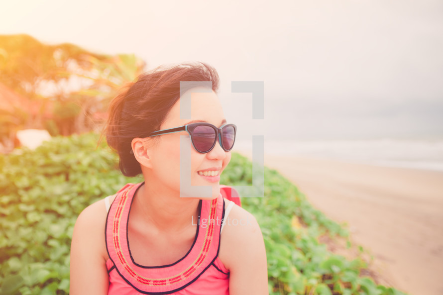 woman in sunglasses on a beach
