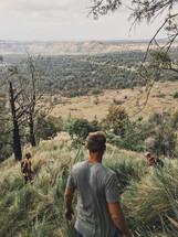 men hiking a mountain landscape