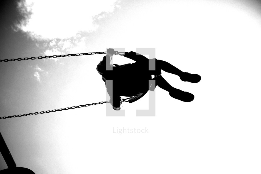 A shot from below of a person swinging