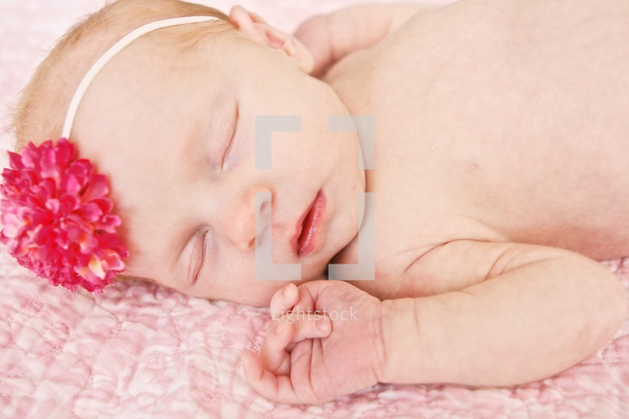 Infant girl wearing pink bow