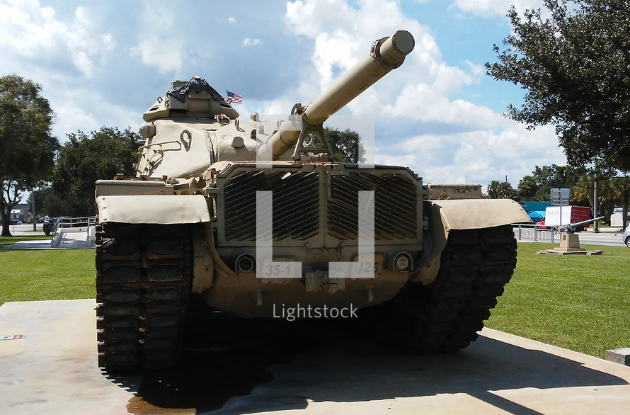 A military grade armored tank rests on display during peacetime to remind us of wartime and previous wars that have been fought to bring peace to the world using military force.